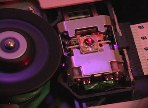 Close up of the interior workings of a CD-room drive Footage