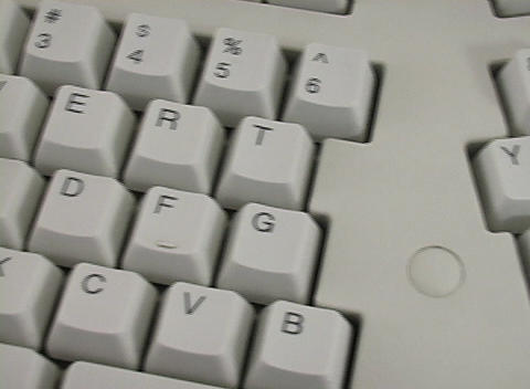 A pan across a computer keyboard Stock Video Footage