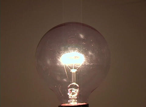 A light bulb slowly extinguishes Footage