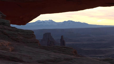A light sky silhouettes a Mesa in Canyonlands National... Stock Video Footage