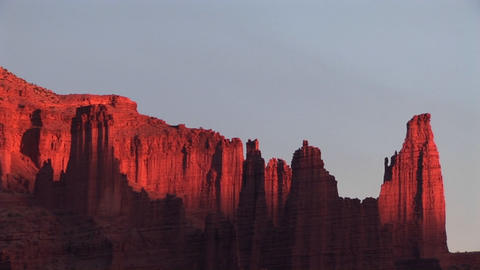 Rays of the sun glance off the upper part of cliffs in the American Southwest desert Footage
