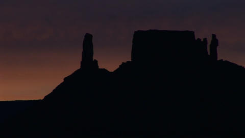 A horizon of desert buttes and rock formations is... Stock Video Footage