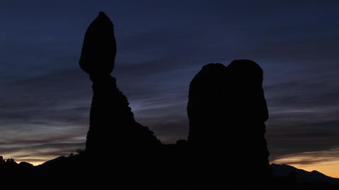 Balanced Rock is silhouetted against a dark sky in Arches National Park, Utah Footage