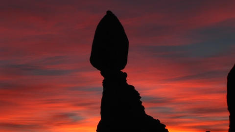 Balanced Rock stands against a brilliant sky Footage