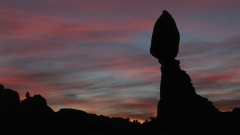 Balanced Rock is silhouetted against a brilliant sky in Arches National Park, Utah Footage