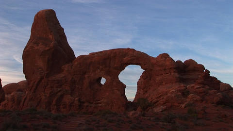 Turret Arch glows at Utah's Arches National Park Stock Video Footage