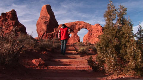 A photographer approaches Turret Arch in Arches National Park, Utah Footage
