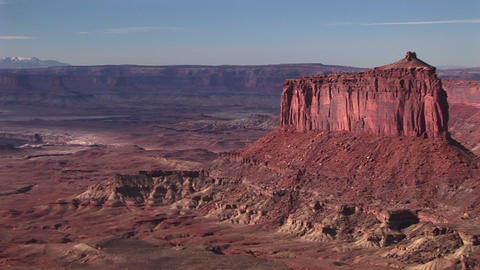 Pan-right slowly across Canyonlands National Park to an ancient American Indian kiva Footage