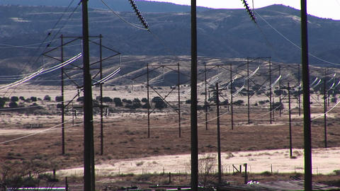 Pan-right across electrical power lines run across a... Stock Video Footage