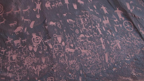 Medium shot of American Indian petroglyphs at Newspaper Rock, Utah Footage