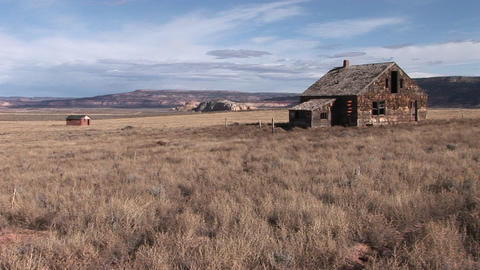 Long shot of an abandoned homestead on a lonely prairie Footage