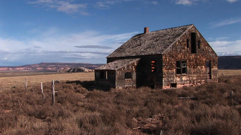 Medium shot of an old abandoned homestead a lonely prairie Footage