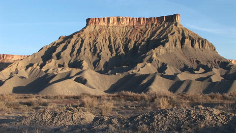 Long shot of a magnificent desert formation that looks like a fortress Footage
