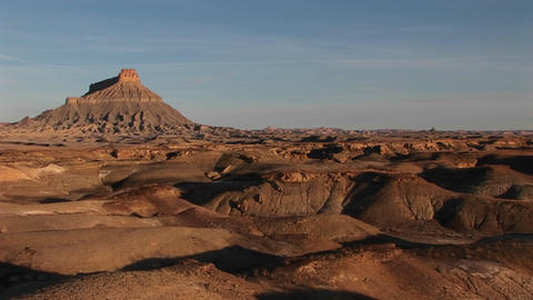 Long shot of a remarkable rock formation in the desert Footage