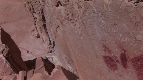 Pan-right slowly across the face of a cliff to an... Stock Video Footage