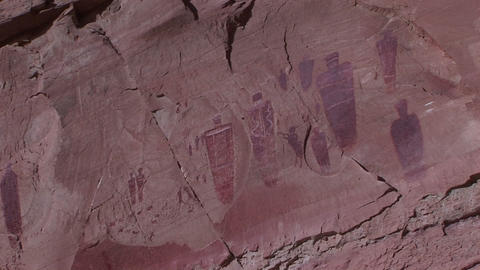 Zoom-in on a desert cliff with American Indian petroglyphs Stock Video Footage
