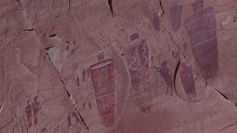 Zoom-in on a desert cliff with American Indian petroglyphs Footage