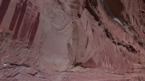 Pan-left across American Indian petroglyphs on a canyon wall Stock Video Footage