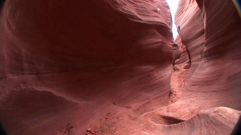POV walking through a narrow passage between rock... Stock Video Footage