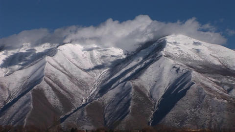 Snow covers the Wasatch mountain range near Salt Lake City, Utah Footage