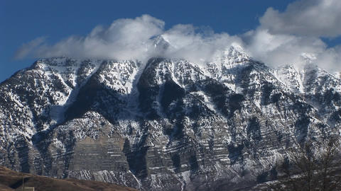 Long shot of rugged mountain peaks Footage