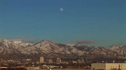 Long shot of Salt Lake City, Utah with the moon rising... Stock Video Footage