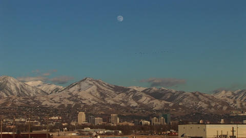 Long shot of Salt Lake City, Utah with the moon rising behind Footage