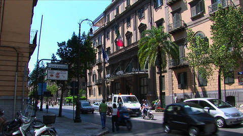 A busy street between stone buildings in Palermo, Italy Footage