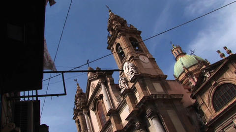 A low dutch angle of a religious building below a cloudy... Stock Video Footage