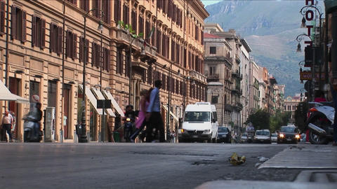Old buildings line a busy street with vehicles and... Stock Video Footage