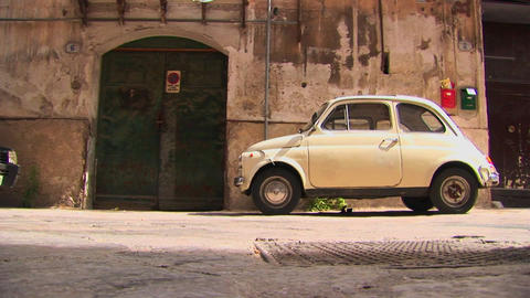 A small car parked outside an old stone building Palermo,... Stock Video Footage