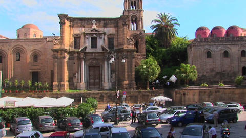 Many cars are parked in front of a religious building... Stock Video Footage