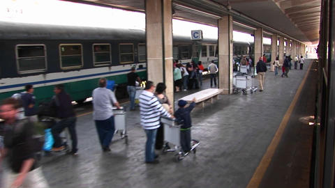 A POV of people waving farewell to passengers on a train in Palermo, Italy Footage