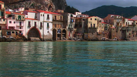 Ocean water near beach houses in Cefalu, Italy Stock Video Footage