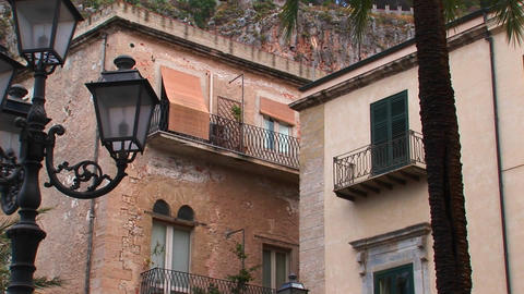 Street lamps and brick buildings are within close... Stock Video Footage