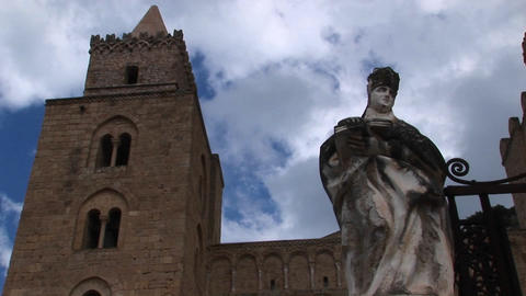 A cloud time lapse moving above a statue of a woman... Stock Video Footage