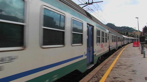 A train passes through a train yard and town in Sicily,... Stock Video Footage