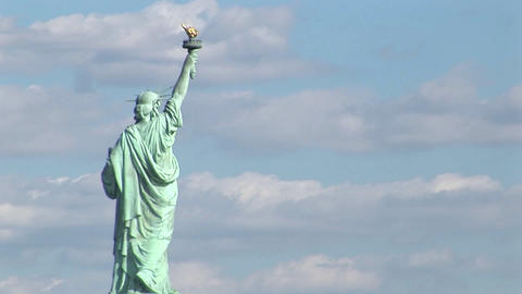 A time lapse of clouds moving over the Statue of Liberty Stock Video Footage