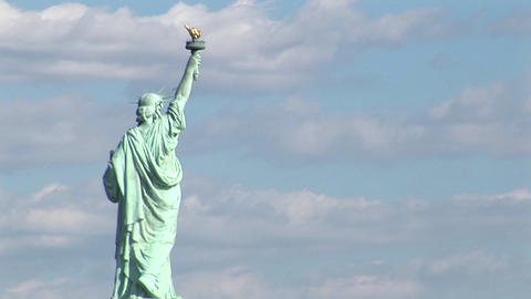 A time lapse of clouds moving over the Statue of Liberty Footage
