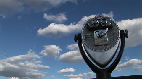 A time lapse of clouds moving over a tourist telescope Footage