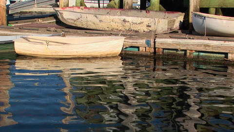 Small row boats tied to a dock in Maine Stock Video Footage