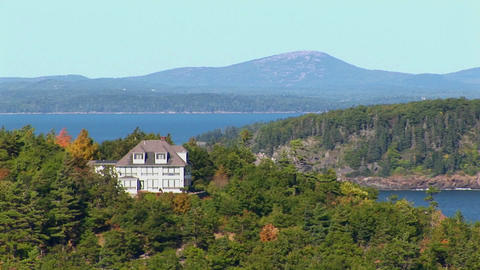 A house and islands are seen in the distance of a forest... Stock Video Footage