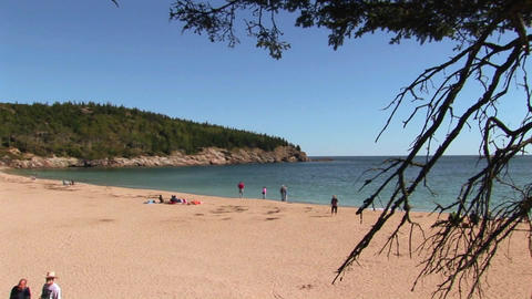 People relax on a beach in Acadia National Park in Maine Footage