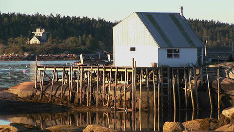 A small lobster village building in Stonington, Maine is on a rock island and pier Footage