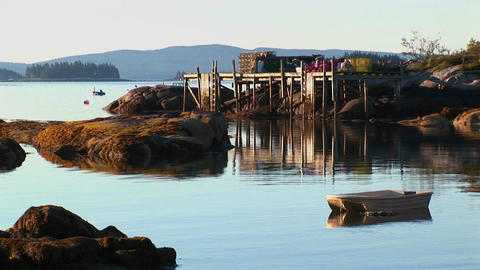 Rocks and a pier are near a lobster village in... Stock Video Footage