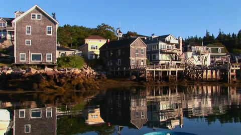 A lobster village in Stonington, Maine is near water at day Footage