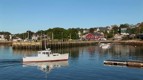A boat stops at a dock next to a man near a lobster... Stock Video Footage