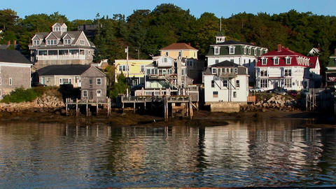 Buildings in a Stonington, Maine lobster village located on a hillside and near water Footage