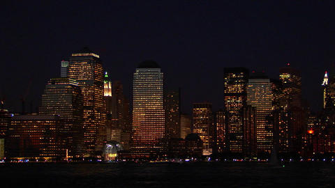 The New York City, NY skyline glows at night Stock Video Footage