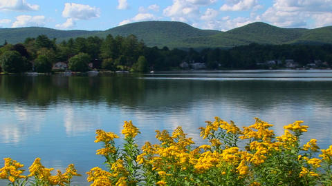 A glassy rural lake in Central Vermont is surrounded by... Stock Video Footage